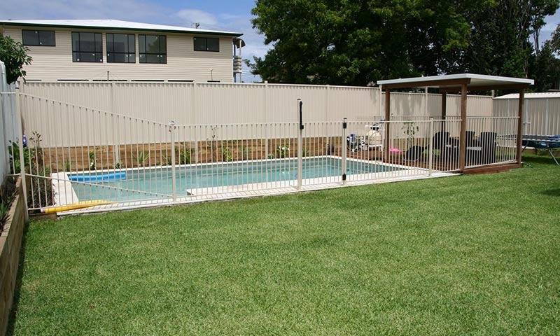white aluminium pool fence