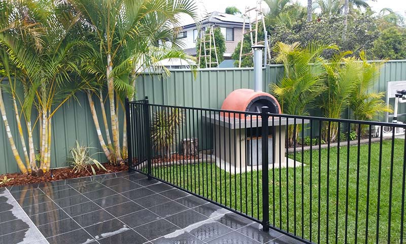 fence and pizza oven