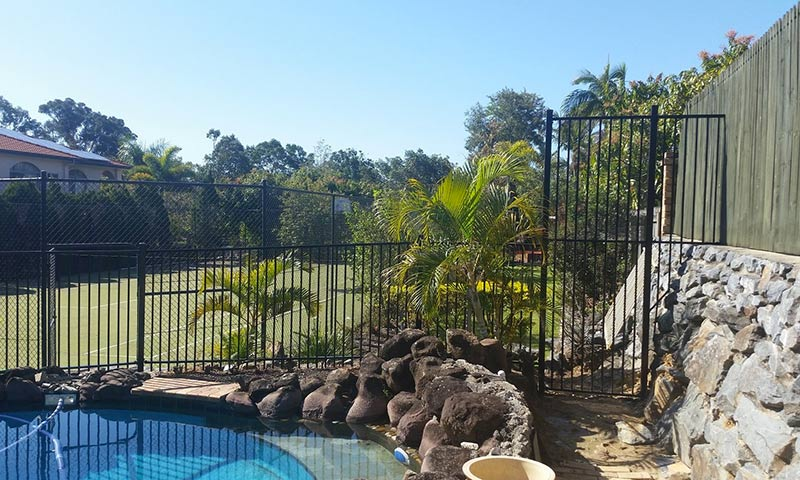 fancy pool with fence