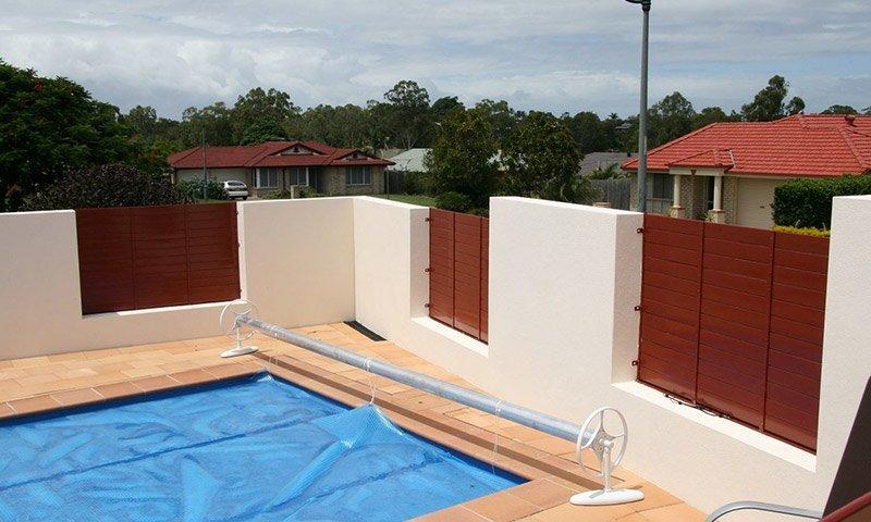 concrete fence around pool