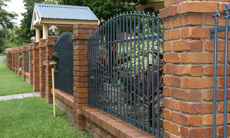 decorative metal and brick fence