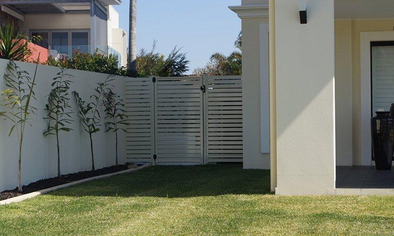 boundary fence beside house