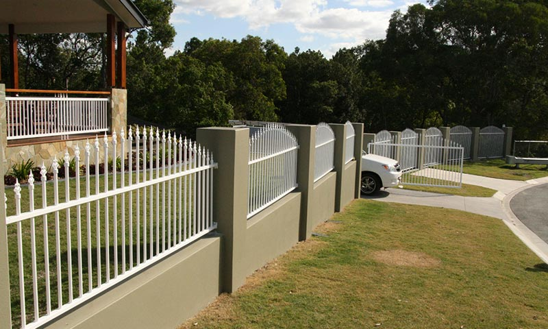 boundary fence with concrete and white metal