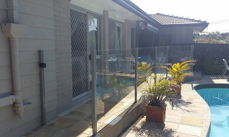 home with glass fence