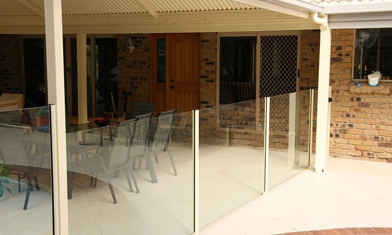 glass fence around outdoor setting