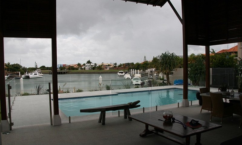 backyard glass pool fence