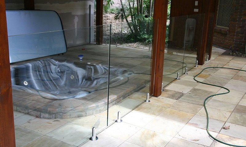 glass fence around spa