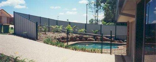 fence surrounding backyard pool