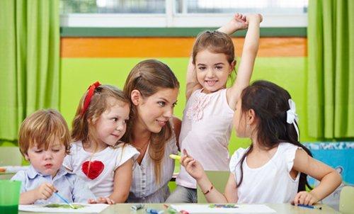 Teacher talking with children