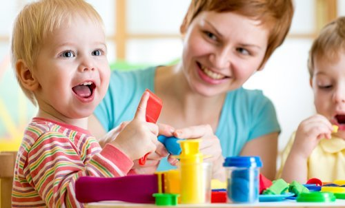smiling toddler learning and playing