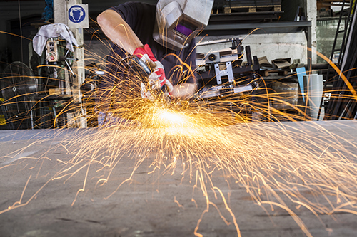 Experts working on machine in La Crosse, WI