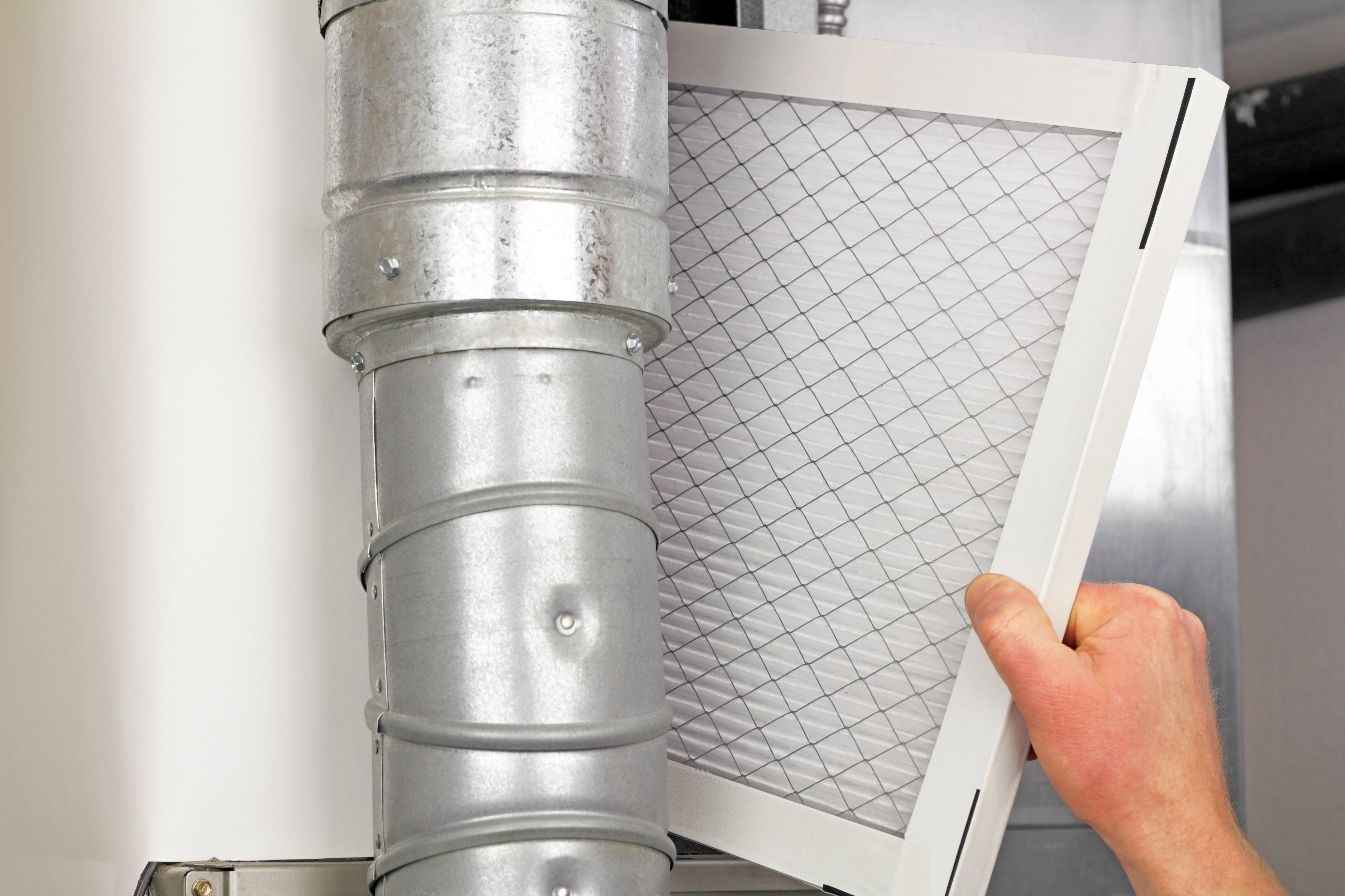 Man replacing furnace filter