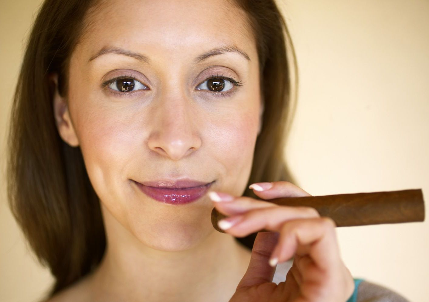 Woman smoking a cigar in a tobacco products shop in Anchorage, AK