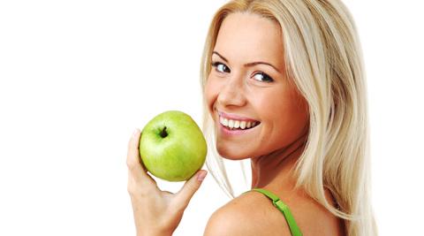 sorriso con mela