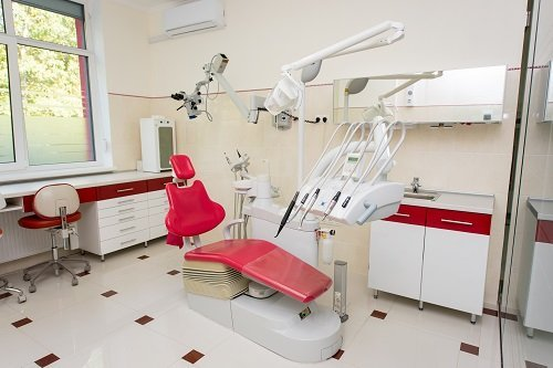 Modern dental units, chairs, equipment, tools and microscope used by dentists