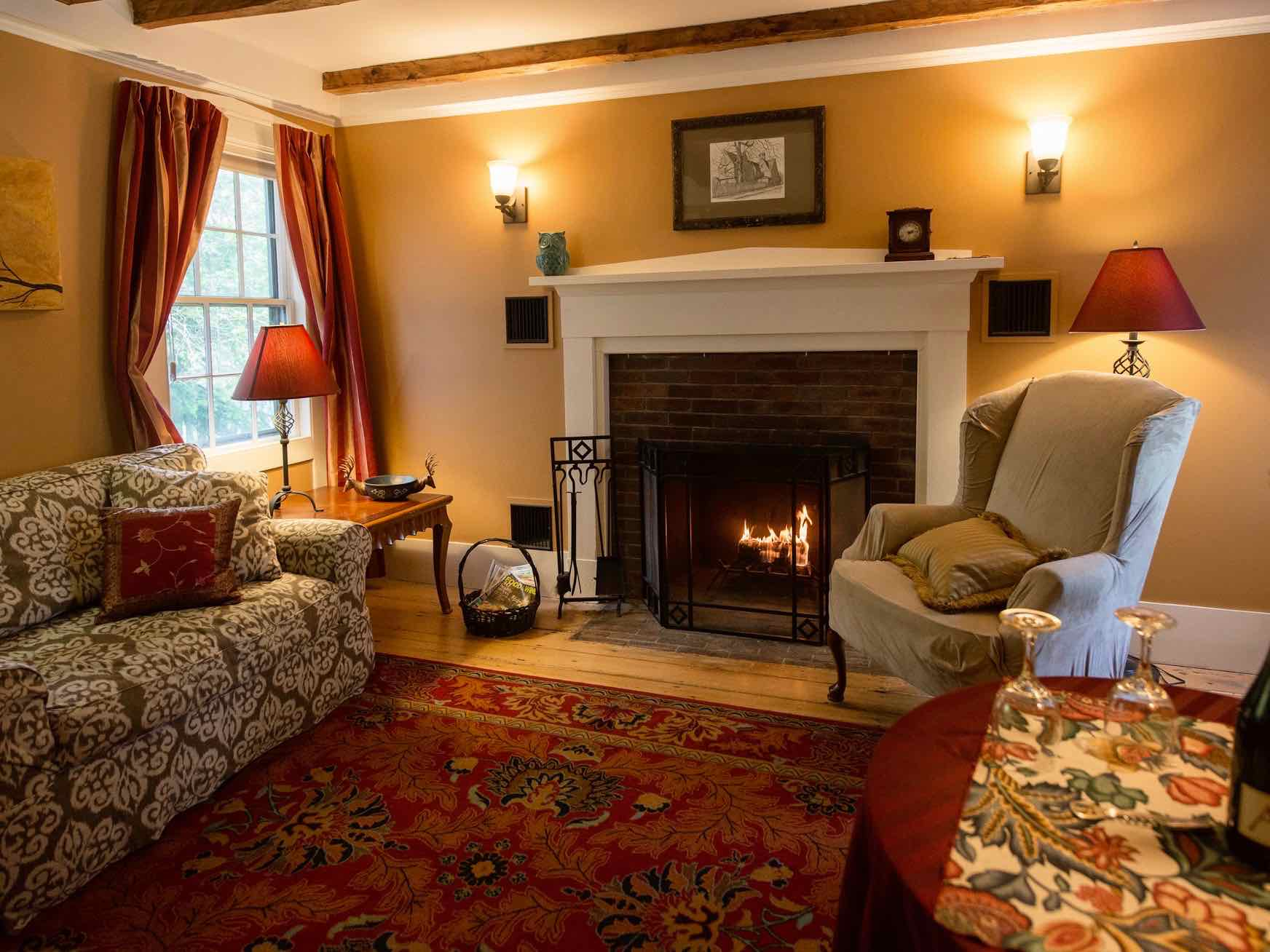 Thumbnail photo of Tavern Suite sitting room with fireplace