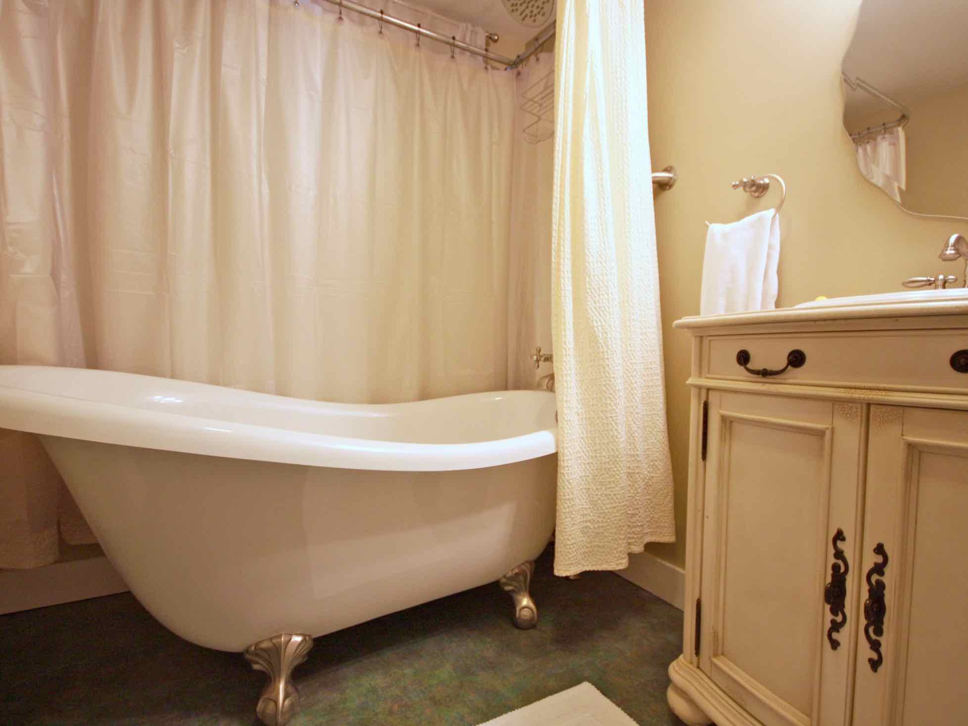 Acadia Suite - Claw-foot bathtub and bathroom at Coach Stop Inn