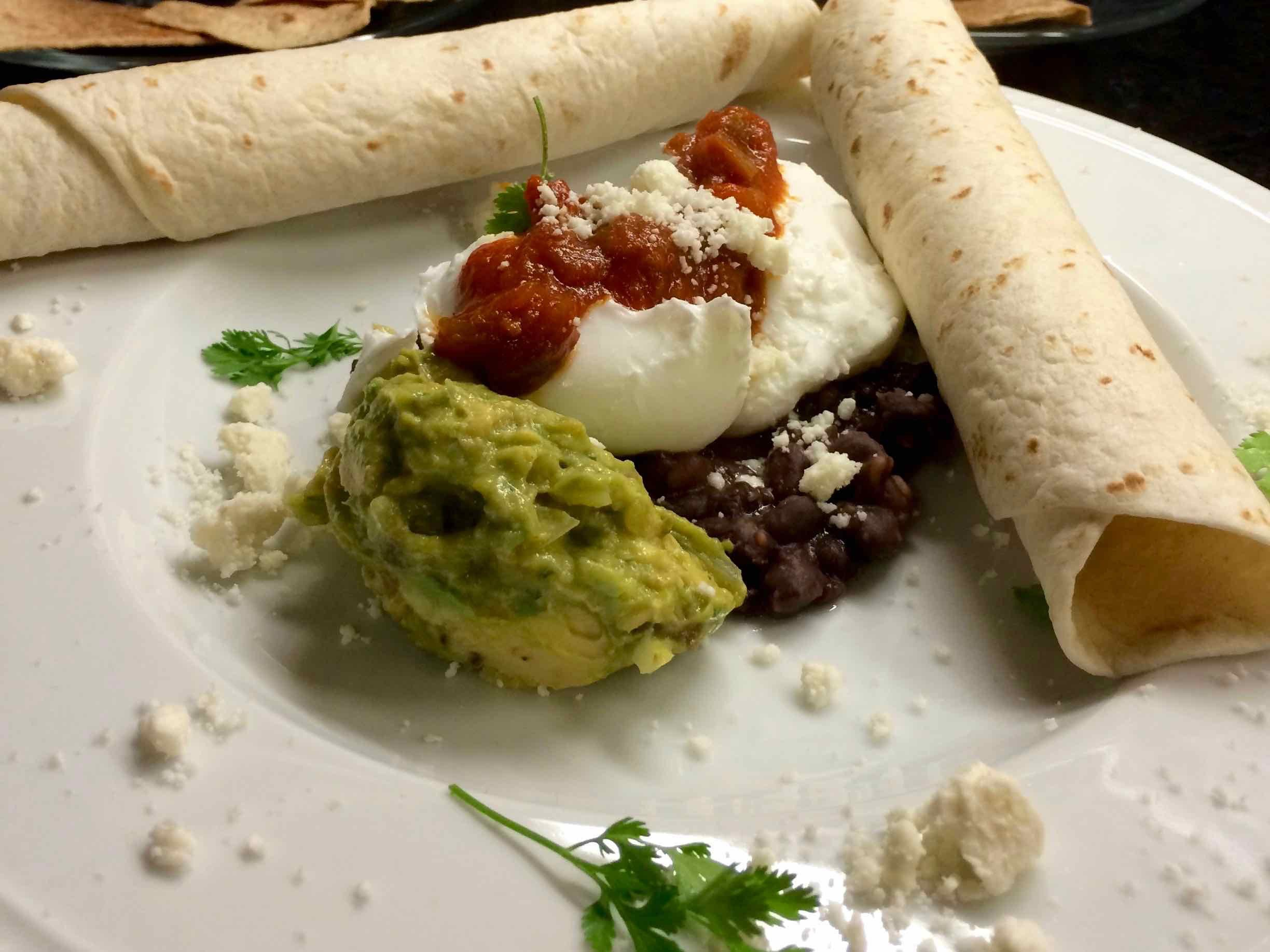 Breakfast at Coach Stop Inn – Huevos rancheros poached eggs with guacamole and salsa