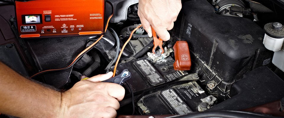attaching cables to car battery terminals