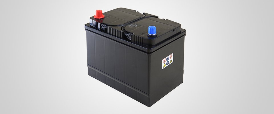 new car battery with blue and red terminal covers