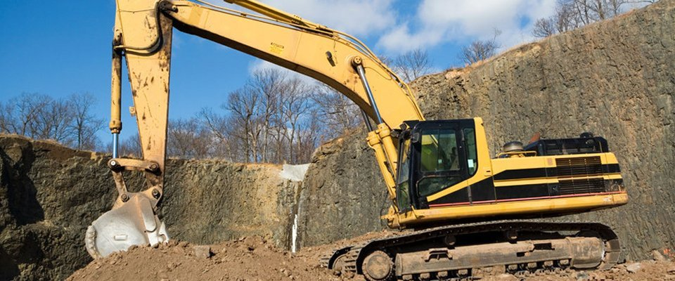 large yellow excavator on site