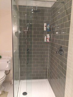 wet room with tiled walling