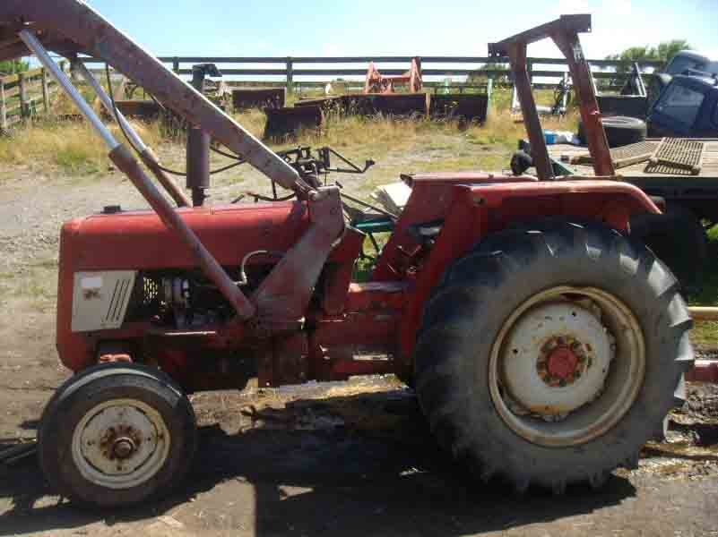 View of old red color tractor