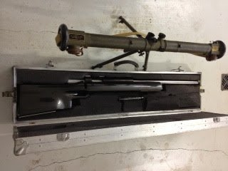 Gun case and 1000 yards rifle.