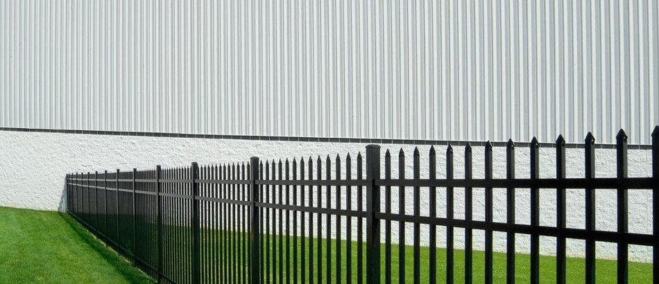 Spike topped security fence protecting an industrial building