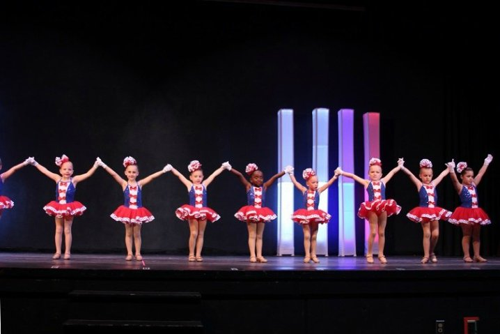 Eight dancers getting ready to bow