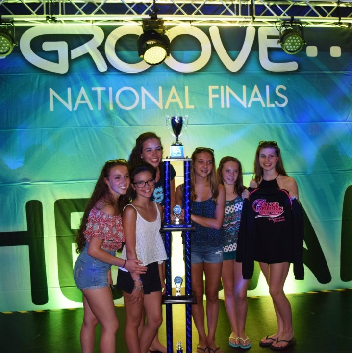 Six Dancers with a trophy at competition