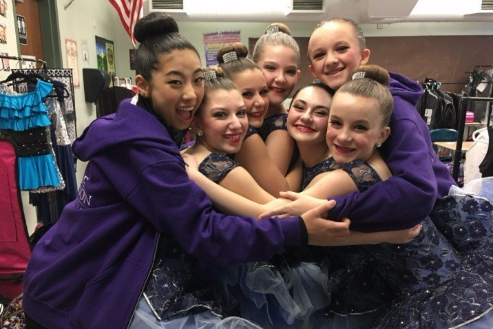 Seven Dancers hugging backstage