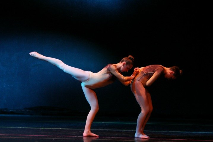 Two dancers in mid stance