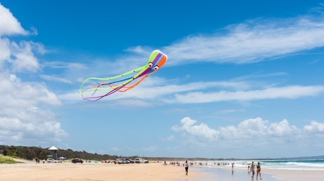 Multi color kite flying in the sky