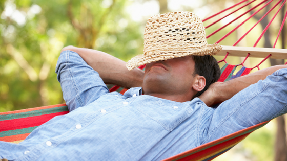 picture of a man napping in  a hammock