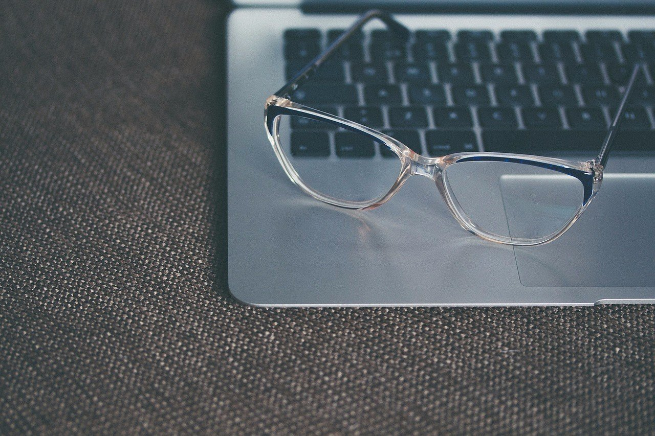 eye glasses sitting on a laptop computer
