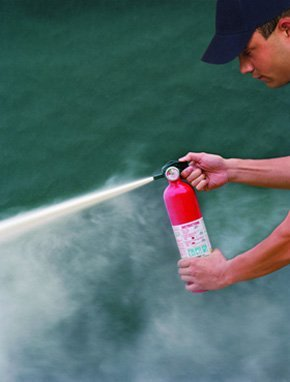 fire extinguishers - Stroud, Gloucestershire - 1st Fire Solutions Ltd - man & extinguisher