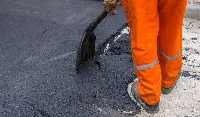 Crack filling on a black top paving driveway in Latrobe, PA