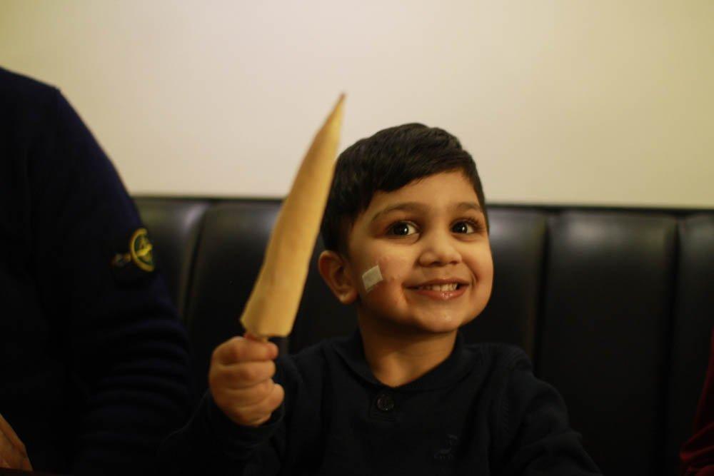 child with a kulfi stick