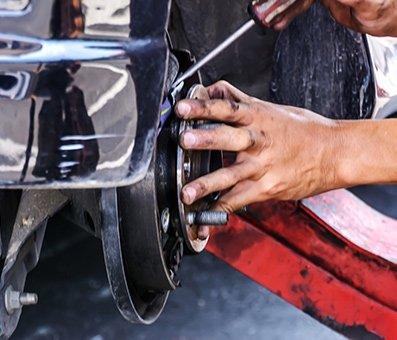 zacks automotive repairing the tyre