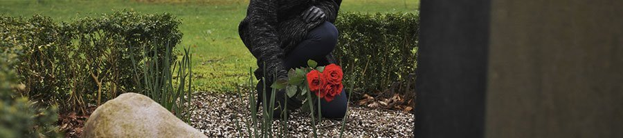 Woman leaving roses for a loved one