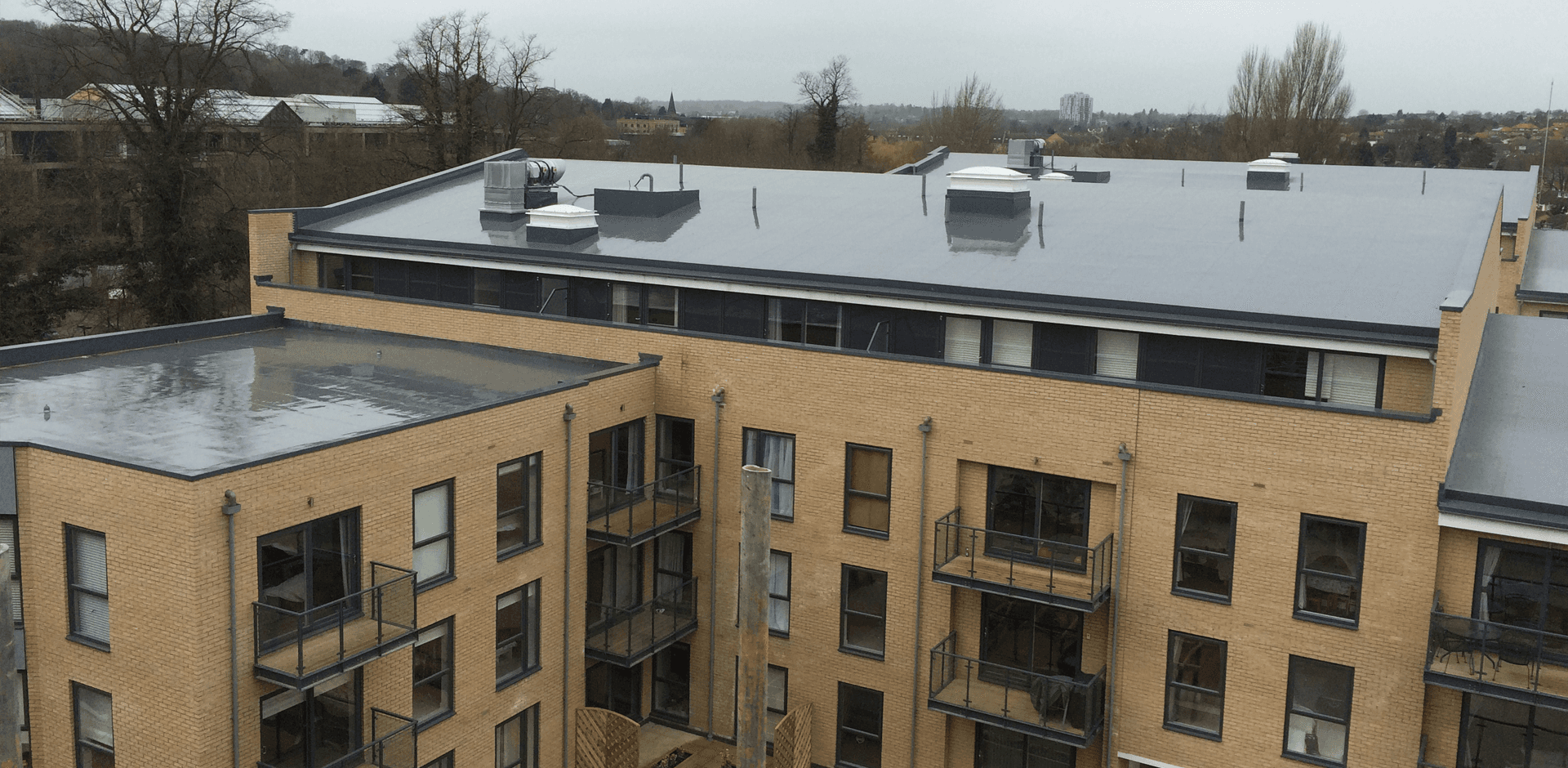 The flat roof on a block of flats and appartments