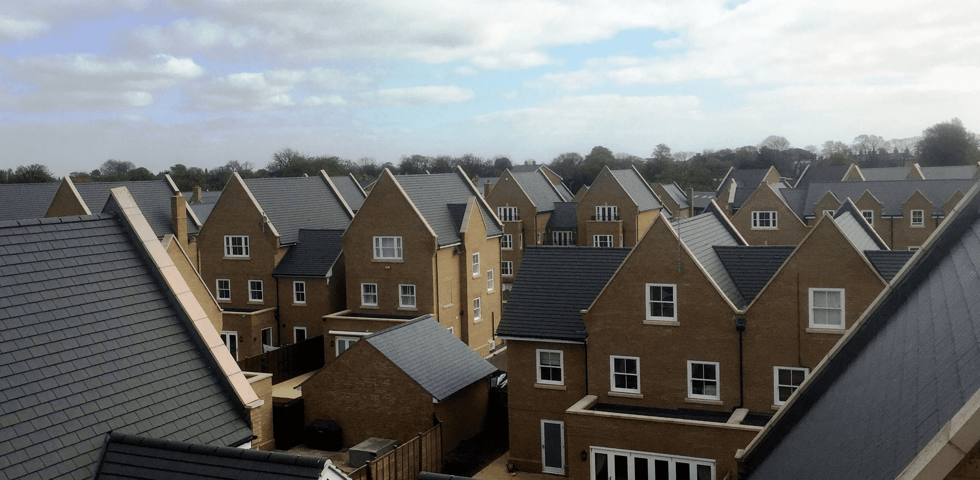 Sky view of roofs across a housing estate