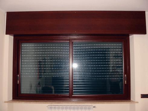 ABL serramenti progetta e costruisce infissi scorrevoli e cassonetti tinta legno per interni.