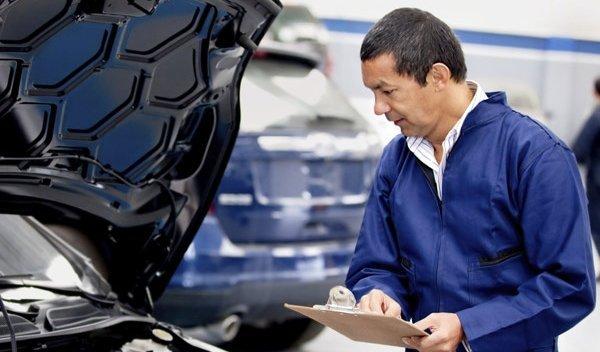 colgrave chris automotive mechanic checking car