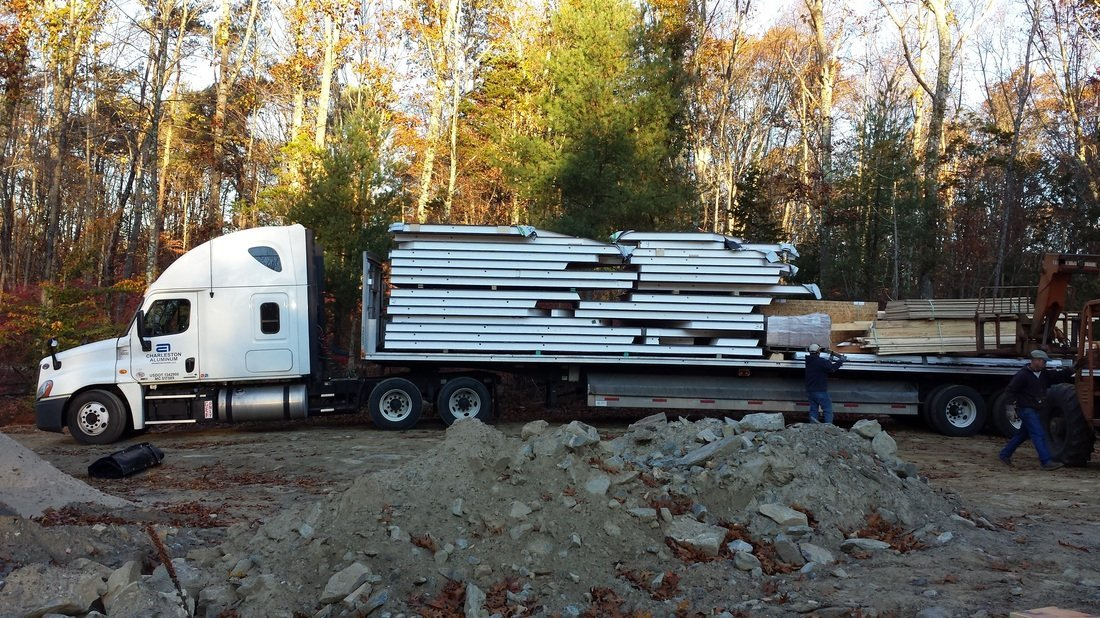 truck delivering structural insulated panels - SIP Building Solutions - Westport, Fairfield, Stamford, Greenwich, Danbury CT