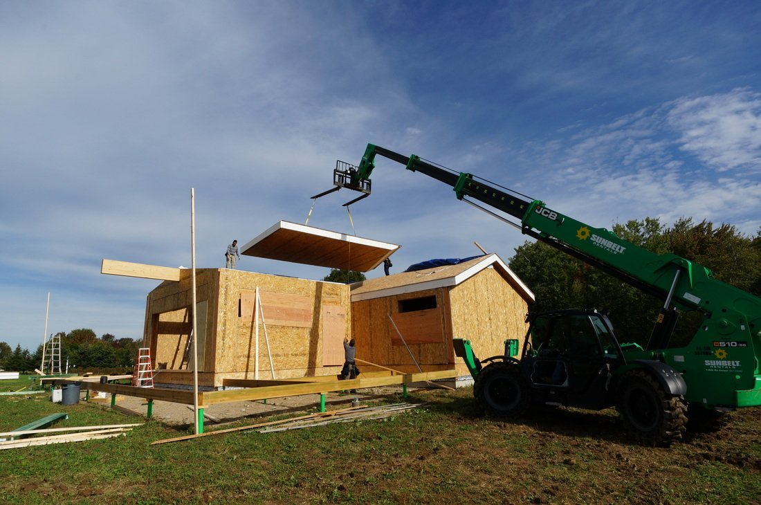crane lifting structural insulated panels - SIP Building Solutions - Westport, Fairfield, Stamford, Greenwich, Danbury CT