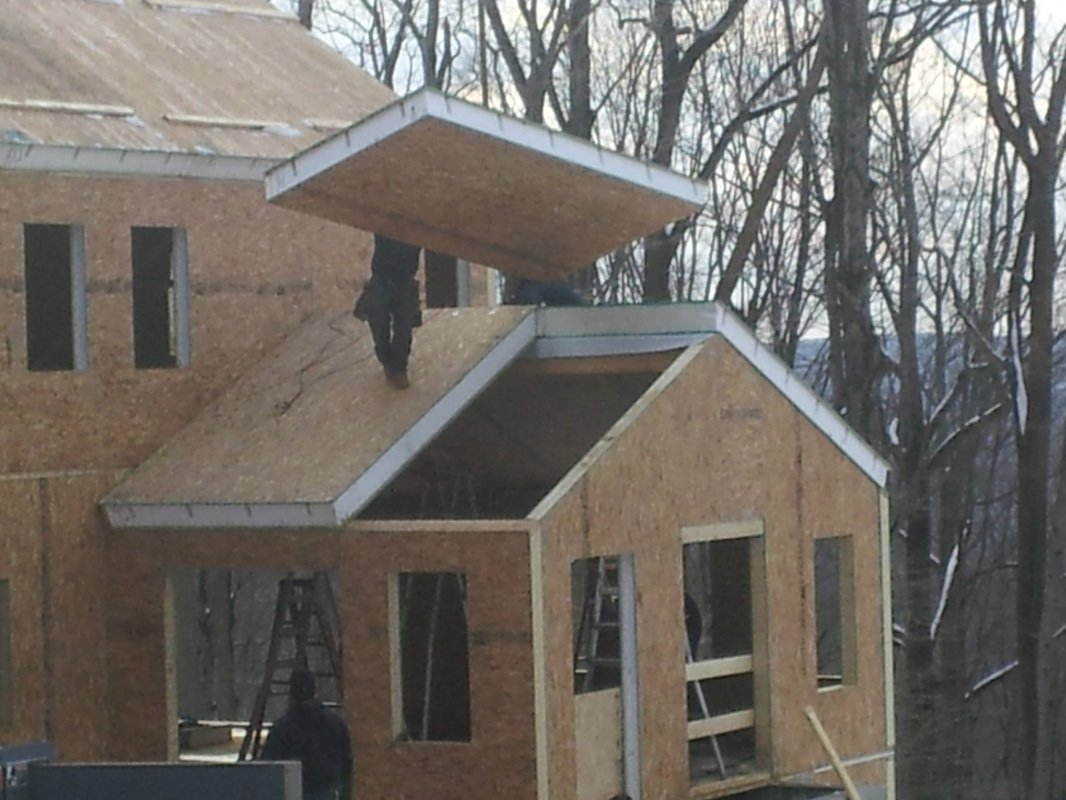 building roof with structural insulated panels - SIP Building Solutions - Westport, Fairfield, Stamford, Greenwich, Danbury CT