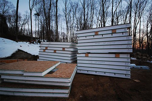 stack of structural insulated panels - SIP Building Solutions - Westport, Fairfield, Stamford, Greenwich, Danbury CT