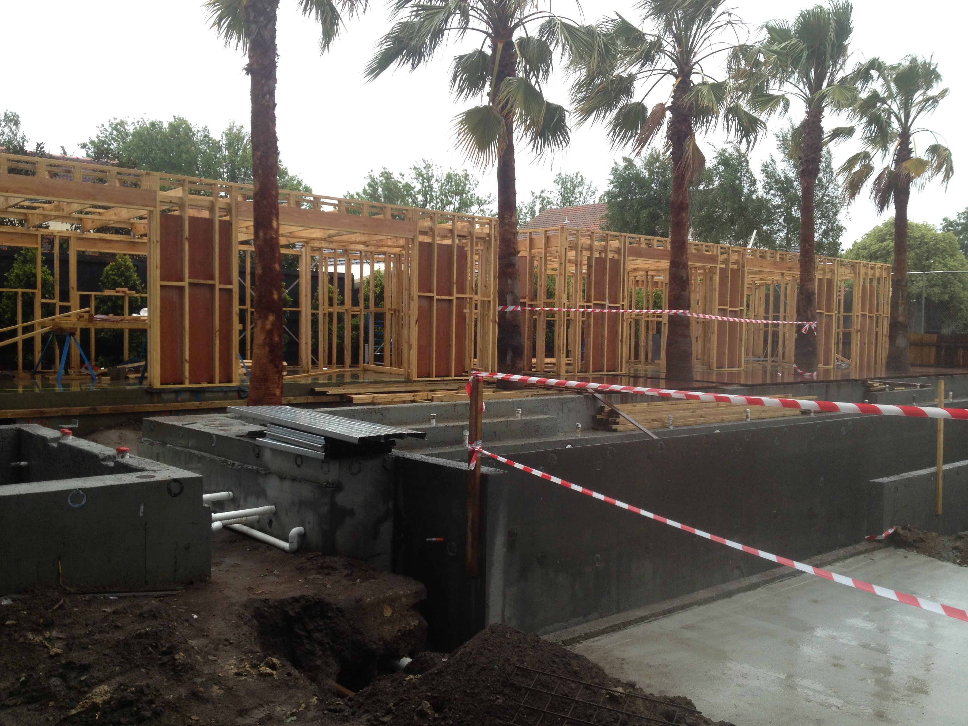 Screw piles used to support foundations for pool house, deck and swimming pool itself